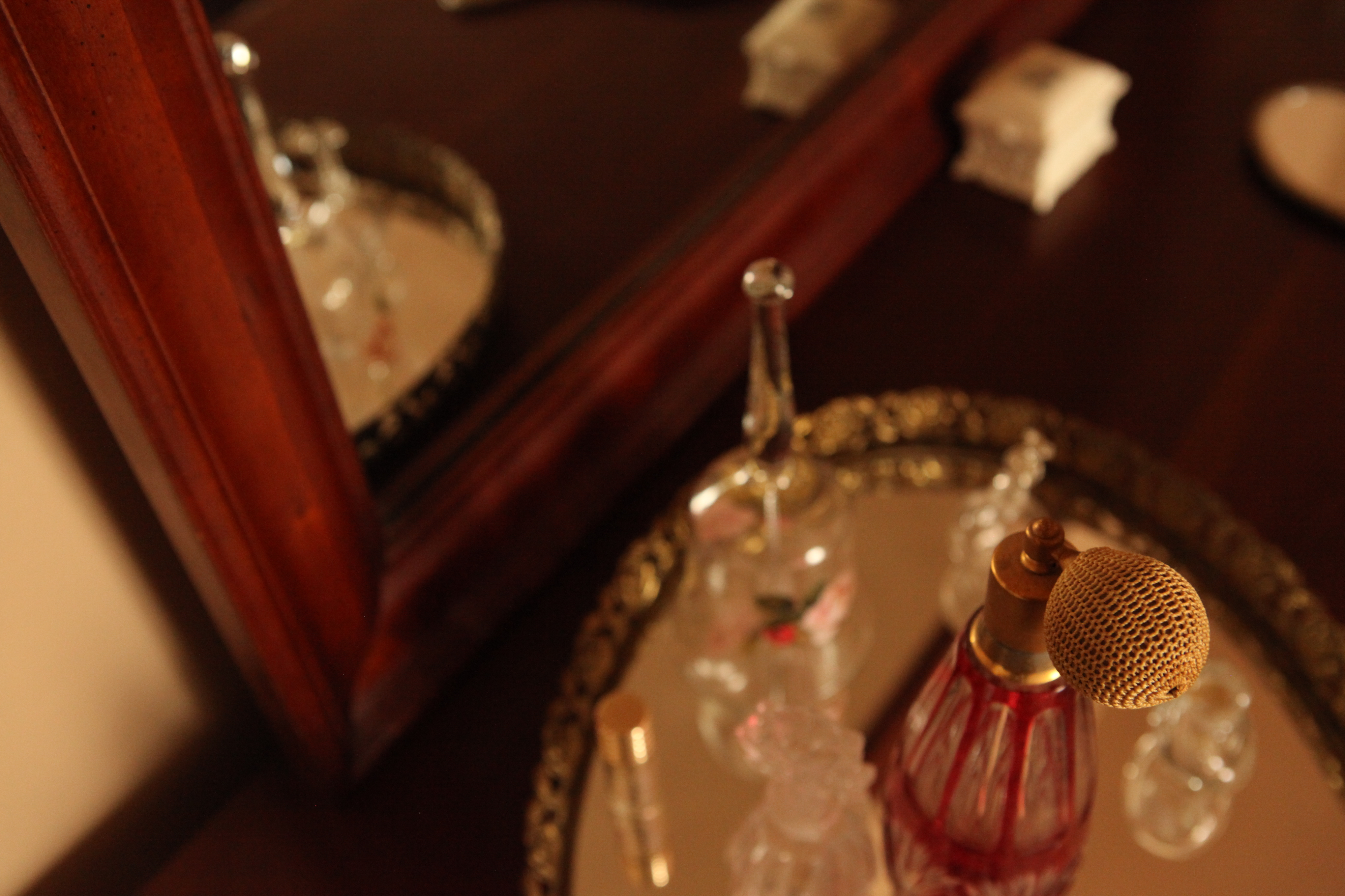 perfume and mirror